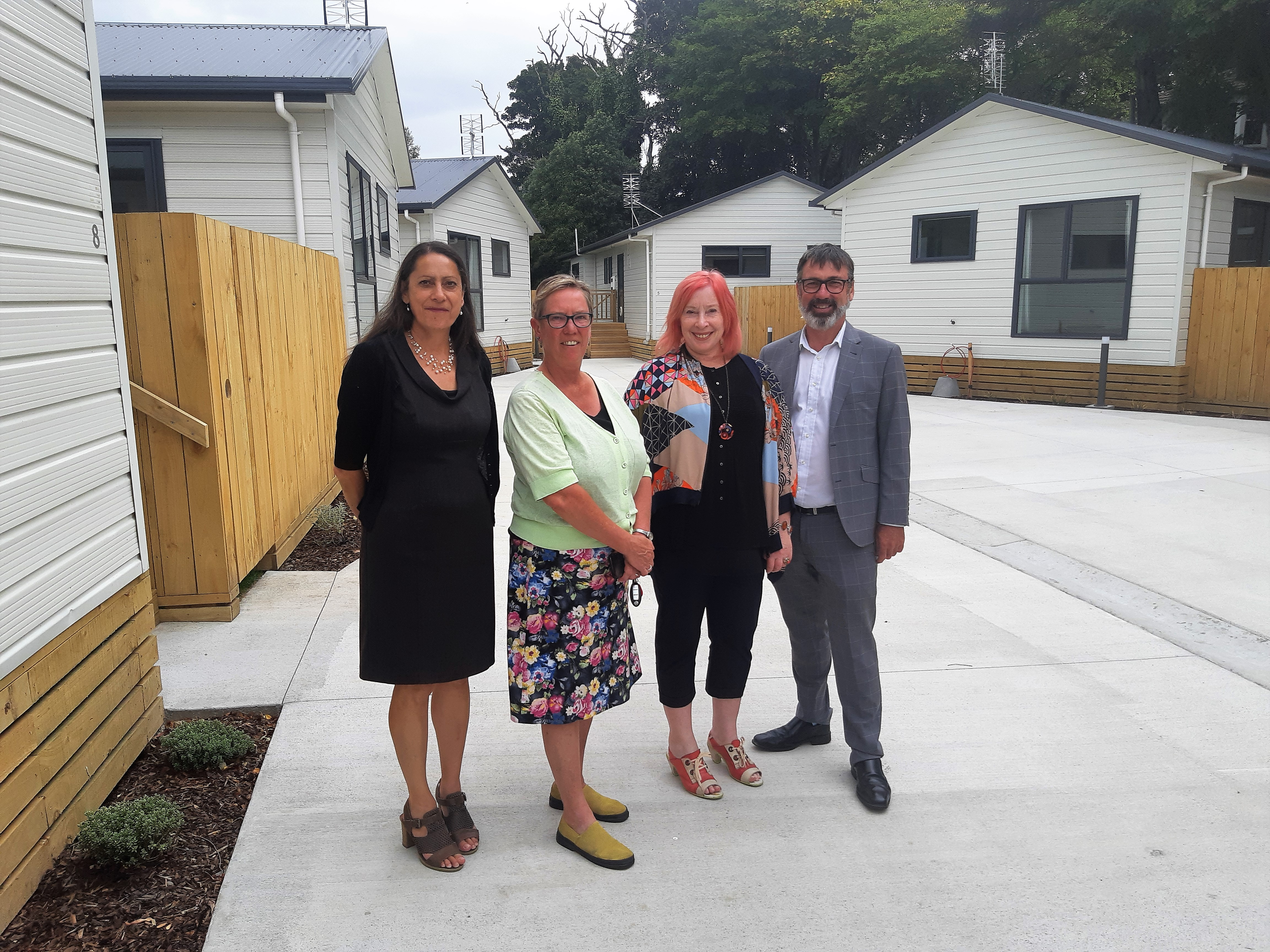 ŌCHT chief executive Cate Kearney (second from right) with Christchurch MPs Poto Williams (left), Ruth Dyson and Duncan Webb at OCHT's first development, Louisson Place, in Opawa, in 2019.