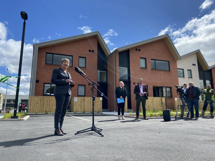 Christchurch Mayor Lianne Dalziel address the crowd at the opening of Korimako Lane. ŌCHT chief executive Cate Kearney and ŌCHT chairman Alex Skinner look on.