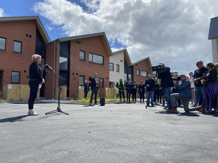 ŌCHT chief executive Cate Kearney tells the crowd Korimako Lane and the bold community housing plan that underpins are something the rest of the country needed to notice, and learn from.