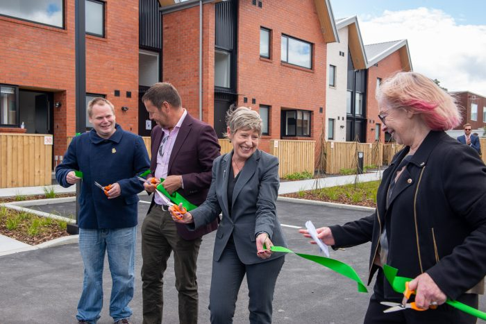 Community housing advocate Stephen McPaike, ŌCHT chairman Alex Skinner, Christchurch Mayor Lianne Dalziel and ŌCHT chief executive Cate Kearney cut the ribbon to declare Korimako Lane officially open.
