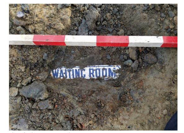 A waiting room sign was found near where Frederick Hall used to live. PHOTO: Underground Overground Archaeology