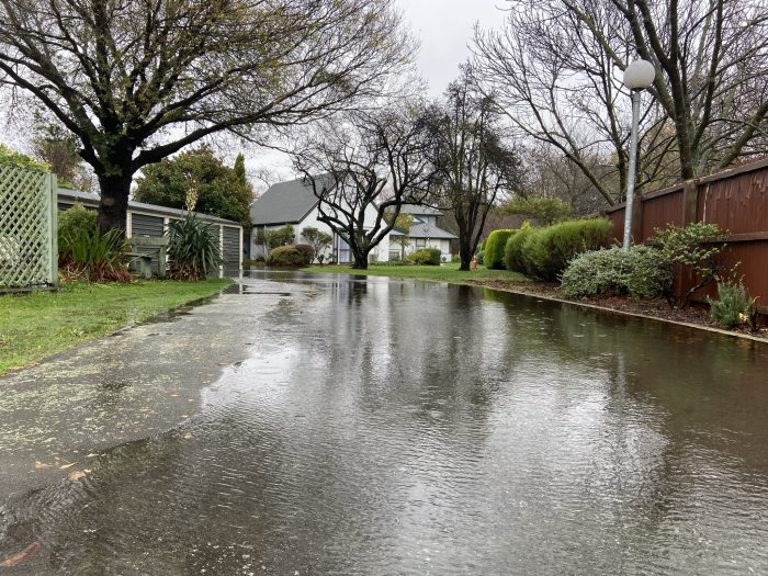 Water ponds at Vincent Place as more than 24 hours of heavy rain takes its toll in Christchurch.