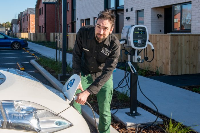Better New Zealand Trust EV ambassador Will charges one of the two Nissan Leafs available for tenant use.