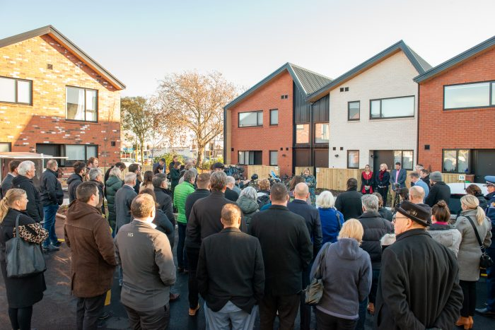 The crowd listens to Housing Minister Megan Woods speak at the opening of Hoiho Lane.