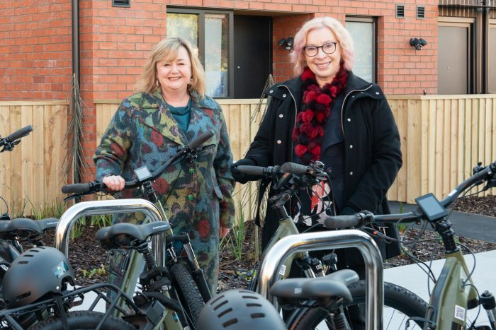 Housing Minister and Energy Minister Megan Woods with ŌCHT chief executive Cate Kearney, and some of the e-bikes available for tenant use.