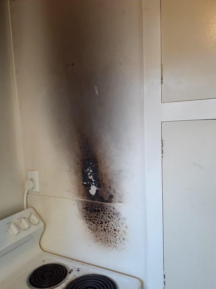 Even a small-scale fire can damage property and threaten household electrics. See how close this fire was to the power plug - only a specialist check can tell us whether the wall's wiring is still safe.